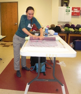 A happy student learning to web felt at Deb Tewell's class at the Estes Park Wool Festival
